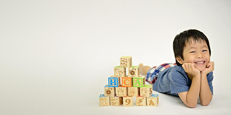 a child with wooden blocks
